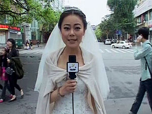 Chinese TV Journalist bride reports on China earthquake in wedding dress