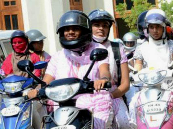 Womens in Bengaluru buying helmets bassed on matching dresses