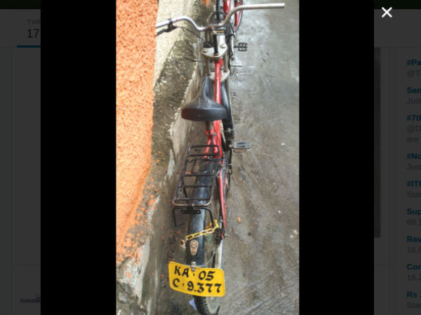 A bicycle with Three wheeler vehicle's license number plate ,