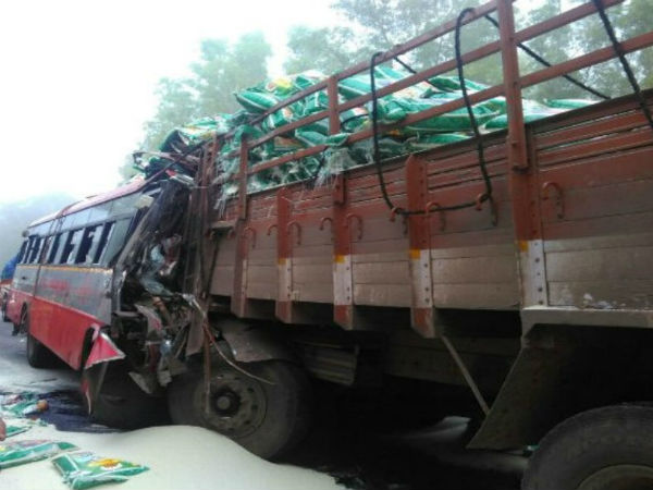Rice bags taken away by people from accident place in Hunsur