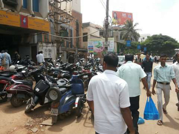 Two wheeler parking on footpath in Hubballi