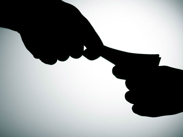 Two Commercial Tax officials caught while accepting bribe
