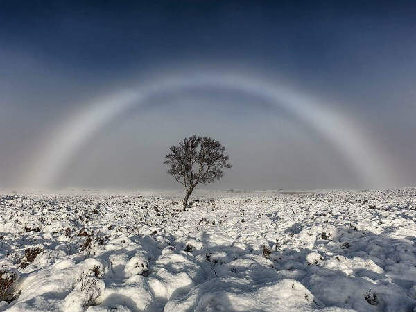 Amazing white rainbow snapped over Scottish moor