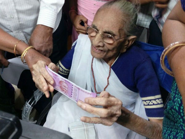 Narendra Modi's mother at bank to exchange notes