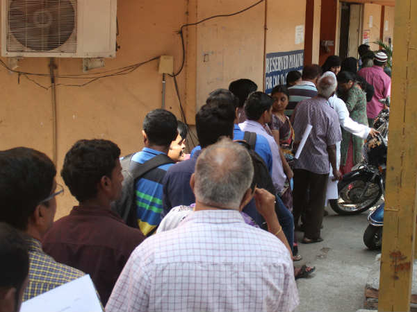 December first: people have no money queue forming in bank and ATM