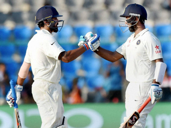 Vijay-Pujara steady India after Rahul's early departure