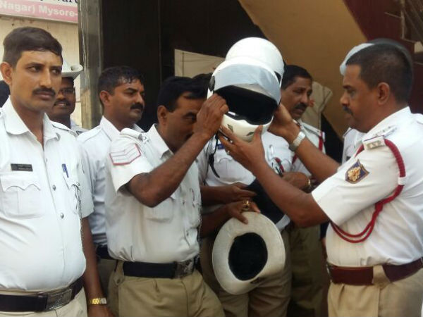 For his birthday an Inspector distributes Helmets to people in mysuru
