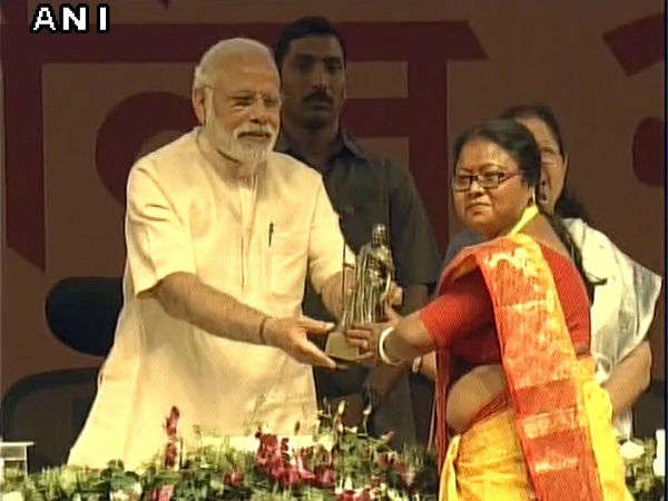PM Narendra Modi's Women's Day event in Gujarat, a woman dragged out of venue