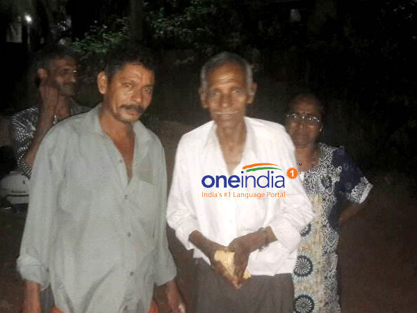 Ullal Inspector Gopikrishn shares a helping hand to an old age person
