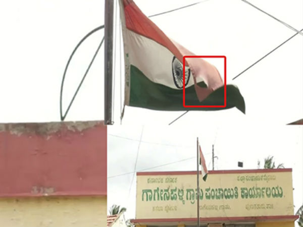 A damaged National Flag of India is flying in a government office in Mysuru