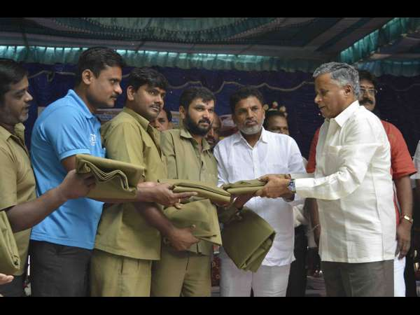 V Somanna distributes free books to poor students