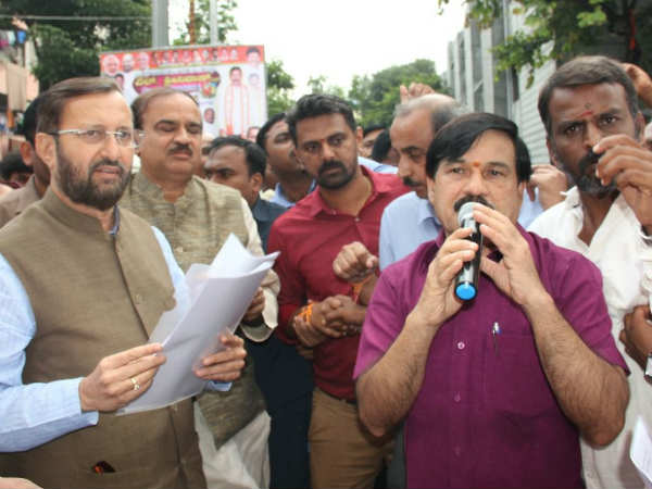 Karnataka state open university employees meets BJP leader PRakash Javdekar in Mysuru