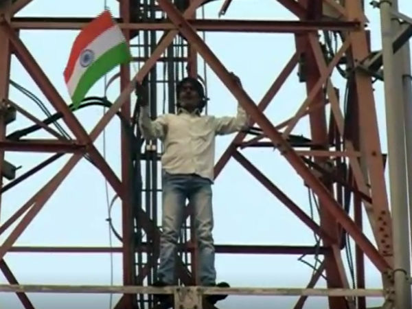 Shigli Basya protesting by climbing up mobile tower in Haveri