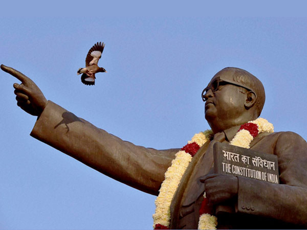 Minority activists demanding an appology from BJP for disrespecting Ambedkar's photo