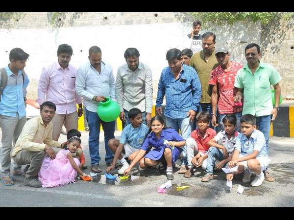 Children's flew paper boat in pot holes near Maharaja stadium Mysuru