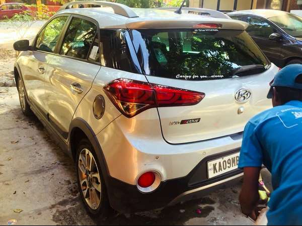 Chamarajanagara boy discovers a easy way to car service with minimal use of water