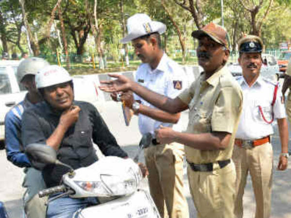 Operation Helmet In Mysuru People Quarrel With Police