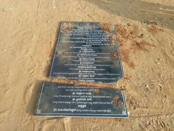 Development works name board damaged in Channapatna