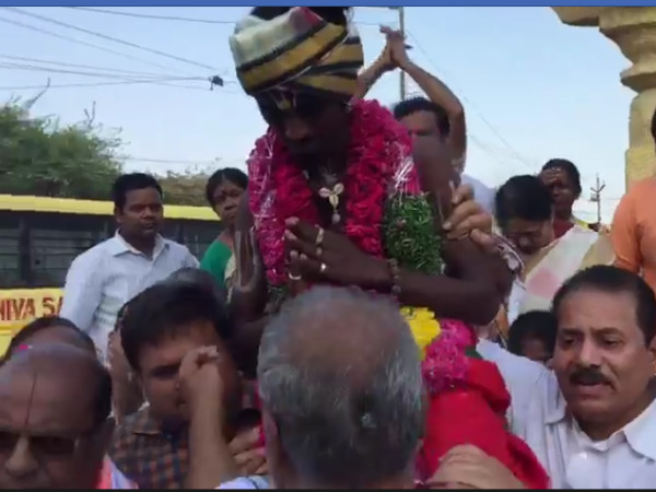 Video Hyderabad Priest Carries Dalit Man On His Shoulders To Send Strong Message