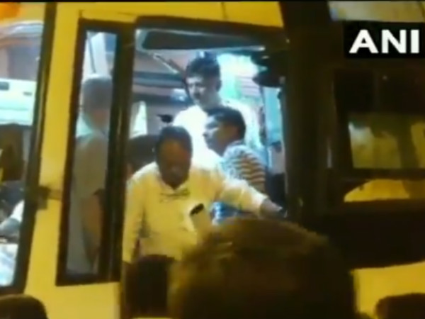 Karnataka election results: Congress MLAs changing buses on Hyderabad highway
