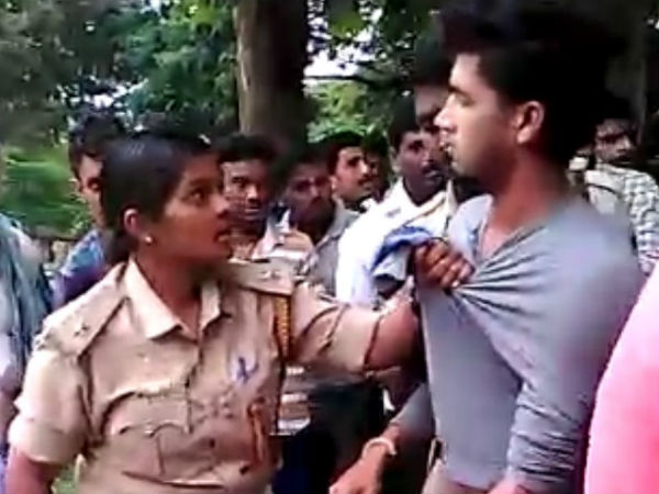 Youth thrashed by public for misbehavior with lady police