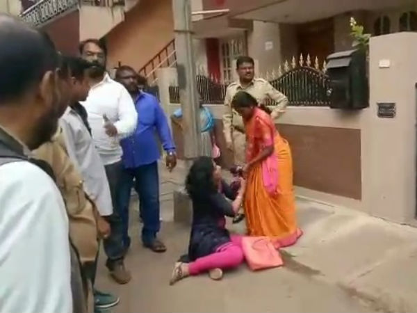 Premakumari attempts to commit suicide in front of Ramdas office
