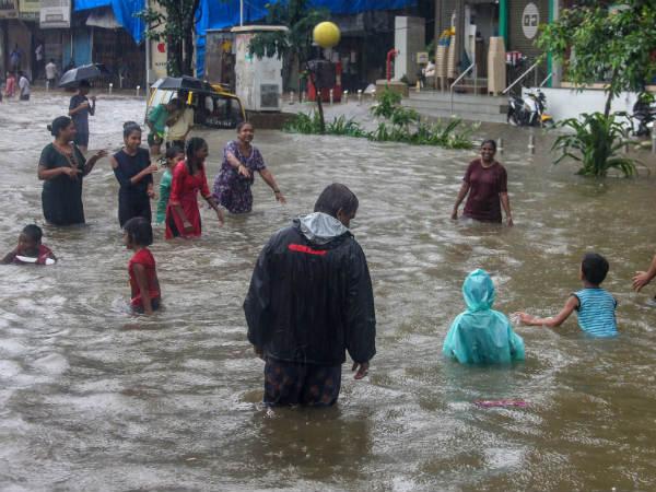 Heavy Rains Continue To Lash Mumbai Local Train Service Hit