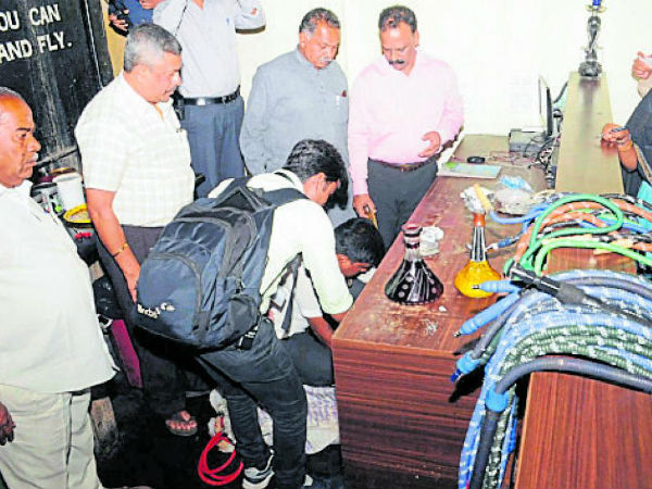 Corporation officers attacked on Hookah centers in Mysuru