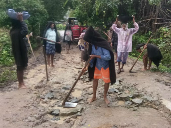 Disappointed By Administration Villagers Repair Road By Themselves