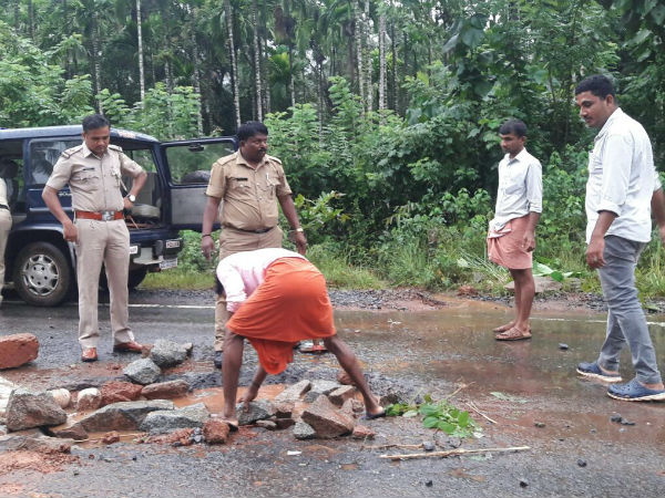 Police officer fills potholes in Sullia