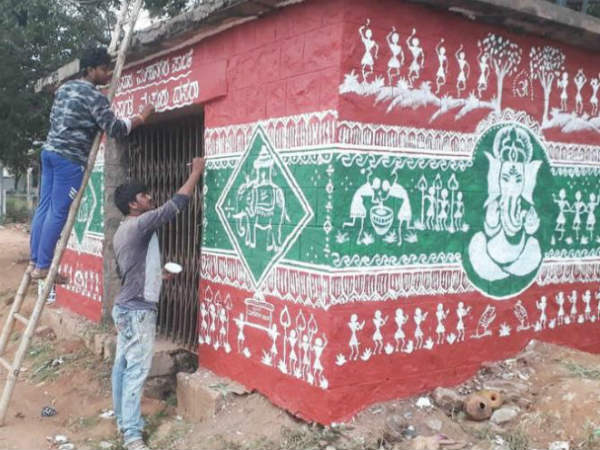 Artists have painted warli art on walls in Mysuru