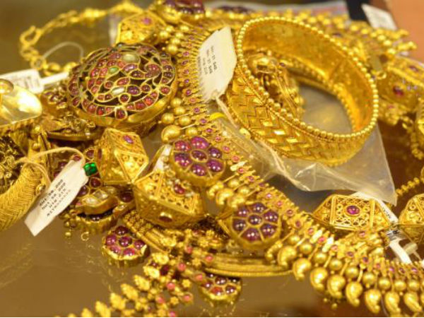 Gold prices surge Rs 200 today, silver rates fall