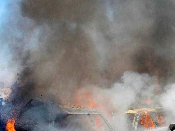 Suicide Car Bombers Kill Many In Somalia