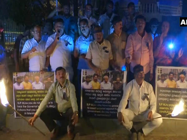 Congress members staged torchlight protest against Karnataka BJP