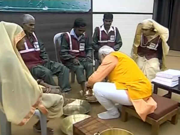 PM Modi Washes Feet of Sanitation Workers At Kumbh, Performs Ganga Arti