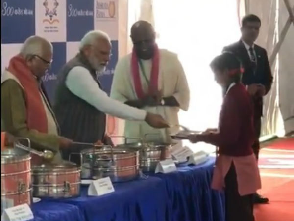 narendra modi serves midday meals to school children in uttar pradesh vrindavan