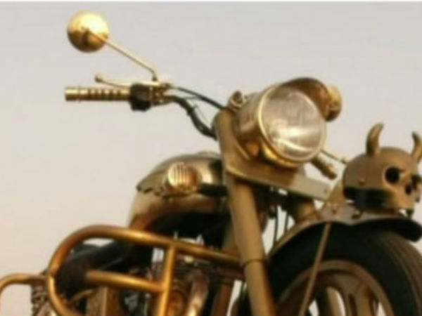Young man made a gold coating on the Royal enfield bike
