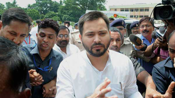 RJD leader Tejashwi Yadavs photo missing