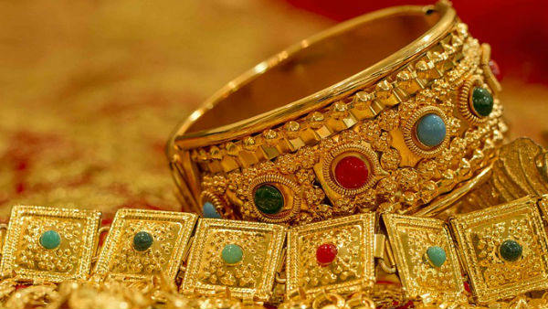 Gold plunges Rs 300 on weak global cues, muted demand
