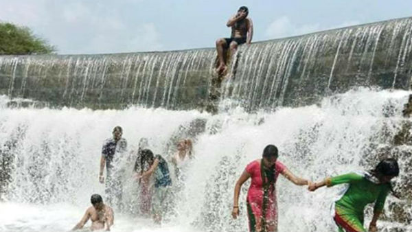 people rushing to play in huchaiahnakatte water falls