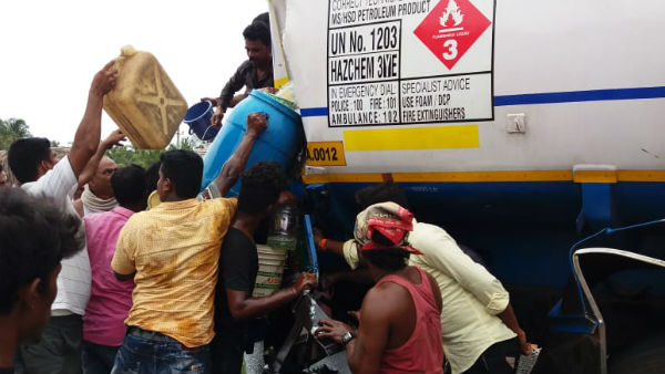 diesel tanker accident people rushed to fill it