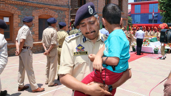 Viral picture: police carrying son of martyred inspector