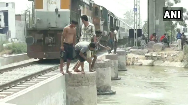 viral video youths diving into a canal while a train was passing by