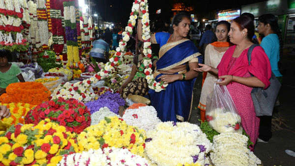 people-are-busy-in-purchasing-items-for-varamahlskmi-pooja