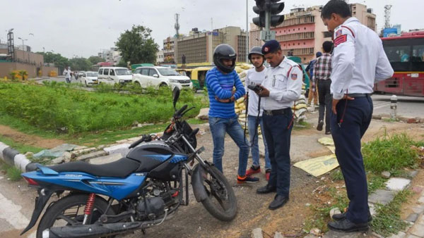 Due To Heavy Fine Under New Traffic Rules Father locks Son At Home