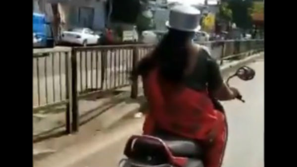 A Video of A woman Wearing Utensil as Helmat Goes Viral