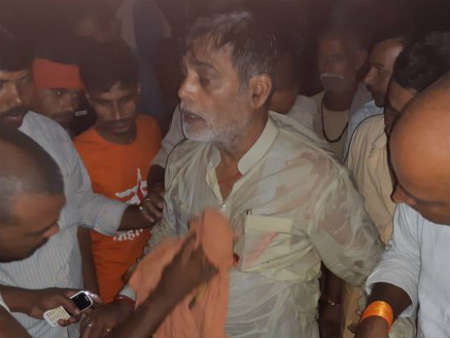 Bihar: BJP MP Ram Kripal Yadav fell into the water during visit to flood affected areas.