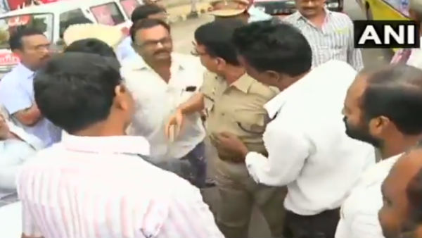 Protest Against Three Capital For Andhra Pradesh: DSP Fell at The Feet Of Protestors