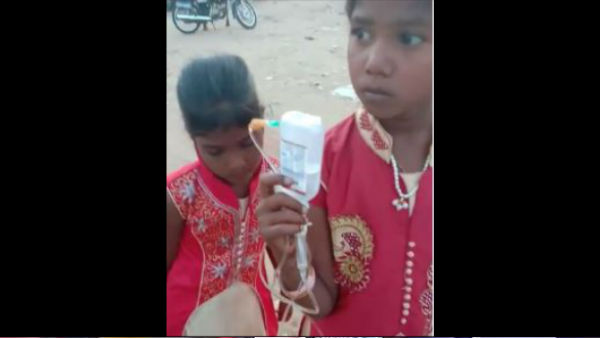 Video Of A Girl With Drip Bottle Went Viral In Challakere