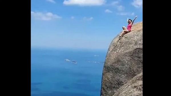 Rio De Janeiro Woman Tourist Poses On The Edge Of 3000ft High Mountain